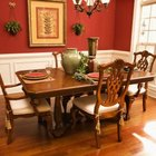 Red walls create a warm, stimulating environment perfect for eating and entertaining.