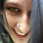 Cropped image of beautiful young woman with nose ring looking sideways