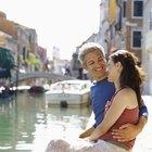 Man kissing smiling woman on cheek