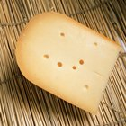 What Is the Difference Between Gouda & Gruyere Cheese?