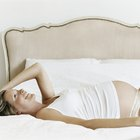 Pregnant Woman Lying on Bed