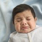 Newborn baby boy on a blue blanket
