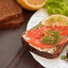 Tuna sandwich on plate and coffee cup
