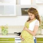 beautiful pregnant girl having breakfast