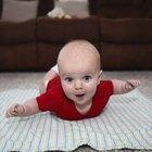 Baby girl (6-9 months) reaching upward, close-up