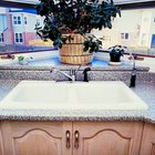 How to cut tap holes in granite sinks