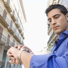 Businessman checking watch outdoors