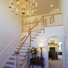 The chandelier makes a statement in a foyer.