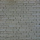 ¿Qué significan las grietas horizontales en una pared de ladrillos en una casa nueva con una losa post-tensada?