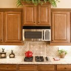 Ferns, philodendrons and spider plants do well over kitchen cabinets.