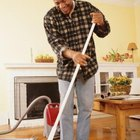 Vacuuming and sweeping often go together when cleaning wood floors.