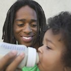 Mother breast feeding baby girl