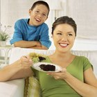 chocolate brownie diced baking paper on wooden table with a