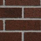 Hazlo tú mismo: ladrillos de imitación en un muro pintado de color rojo profundo