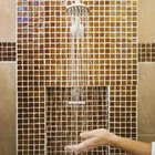 Glass tiles are easy to clean in the shower.
