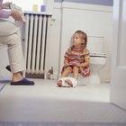 ¿Qué tipo de problemas físicos están asociados con el entrenamiento para ir al baño?