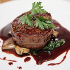 Fresh raw Prime Black Angus beef steaks on wooden board