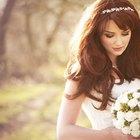 bridesmaid adjusting the bride's wedding gown