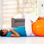 Woman doing press-ups during her pregnancy