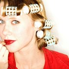 Cropped woman in curlers