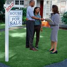 At What Point in the Selling Process Does the Seller Sign Over the House Title?