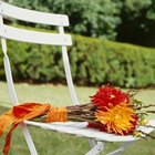 Folding chairs can be transformed with paint and tulle for a formal look.