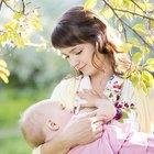 Newborn baby gets breastfeeding