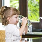 Little boy drinks milk coctail