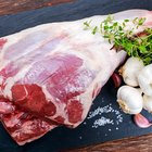 Raw boneless lamb leg with garlic and rosemary