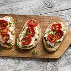 Stromboli stuffed with cheese, salami, green onion and tomato sauce