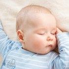 Newborn sleeping in blanket
