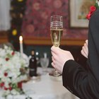 Waiter holding tray of champagne, focus on champagne flutes