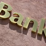 Apply for a business loan at your local bank or credit union.