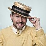 Man wearing a straw boater hat