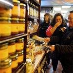 People sample olive oils inside market in Brooklyn, NY.