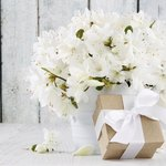 White bouquet of flowers on table.