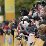 Fans with cameras at bicycling event