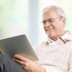Man researching on digital tablet