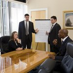 Board members in meeting.