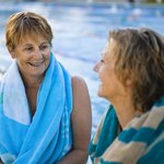 Two woman talking at pool