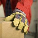 man wearing gloves in wareheouse