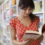 Woman browsing through book at store