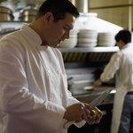 A chef de partie working in kitchen