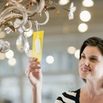 Woman looking at chandelier's price tag