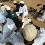 Muslim men from Darfur reading Koran in Sudan mosque