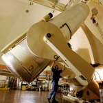 A Oschin 48 inch telescope being readied