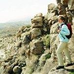 Woman hiking in desert mountains