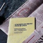 Unemployment insurance information with newspaper.
