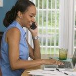 Woman on phone paying bills