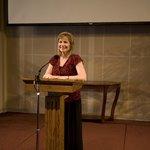Giving a sermon into a microphone